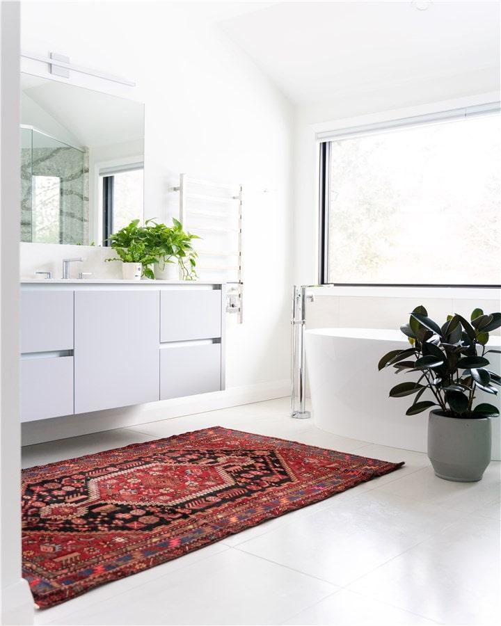 Image d'une salle de bain blanche par zenity design rénovation